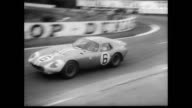 / drivers run to their cars at the beginning of the 24 hour Le Man's car race / cars race away while the crowd look on / film bounces from car race...