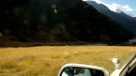 Driving along remote mountain road