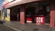 SIDE POV Driving along shops and bars / Miami, Florida, USA