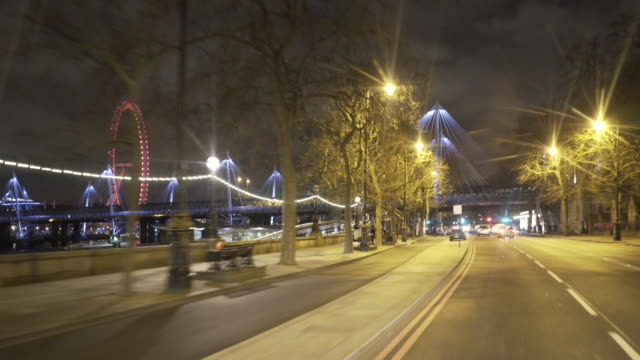 Driving along the River Thames and under Waterloo Bridge .