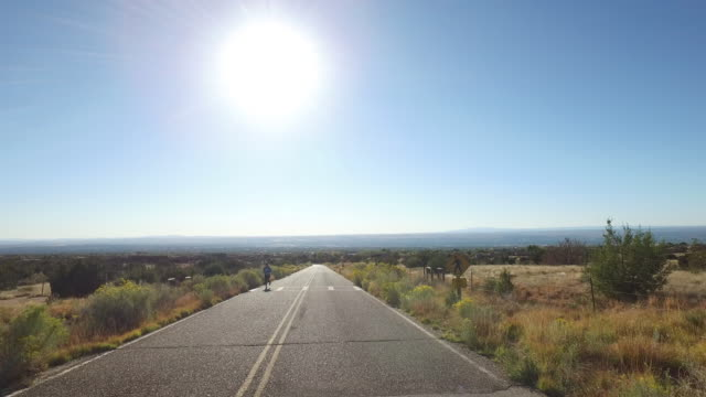 Driving and runner in Albuquerque, New Mexico