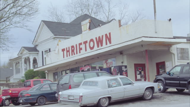 POV Driving by Thriftown convenience store in small town / Georgia, United States