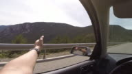 Driving car on mountain road from point of view.