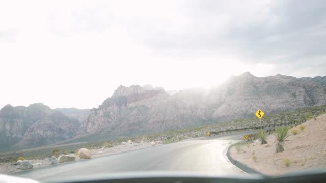 POV driving car on road in scenic landscape