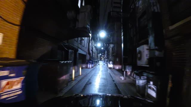 Driving down a narrow City Street