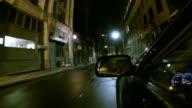 Driving down a narrow urban street