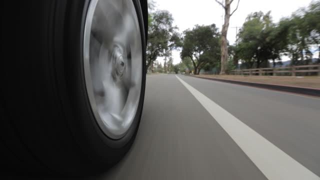 POV Driving down asphalt road / Los Angeles, California, United States