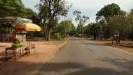REAR POV WS Driving down Cambodian town street / Angkor Wat, Siem Reap, Cambodia