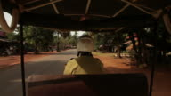 POV WS Driving down Cambodian town street / Angkor Wat, Siem Reap, Cambodia
