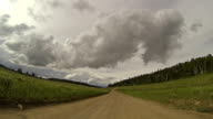 Driving down country dirt road in Colorado; personal perspective