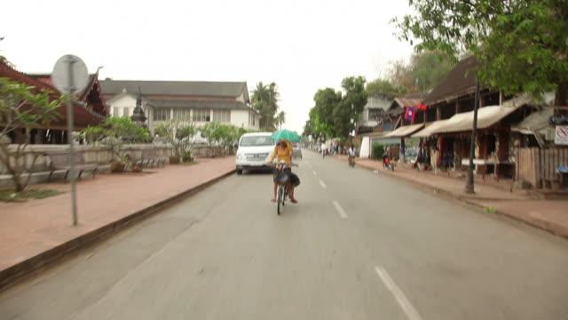 WS REAR POV Driving down street in town / Luang Prabang, Laos