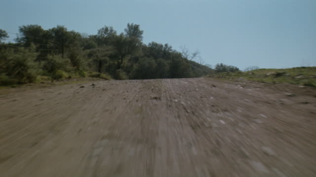 CAR POV Driving fast down rural dirt road