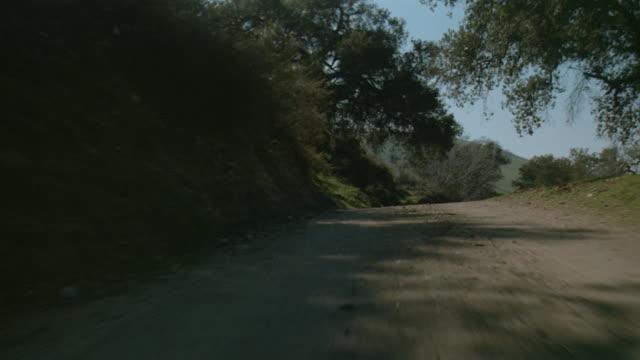 CAR POV Driving fast down rural dirt road
