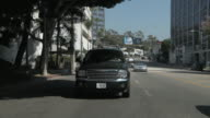 WS POV Driving from sunset strip area into Beverly hills / West Los Angeles, California, USA
