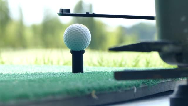 Driving golf-ball form the golf ball dispenser