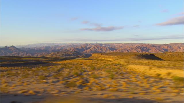 SIDE POV, Driving in desert landscape near Boulder City, Jackass, Nevada, USA