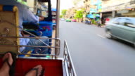 Driving in the city of Bangkok with colorful tuk tuk Rickshaw from personal perspective during travel vacations.