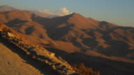 Driving on a dirt road in the desolate Atacama desert mountains