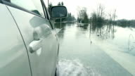Driving On A Flooded Country Road