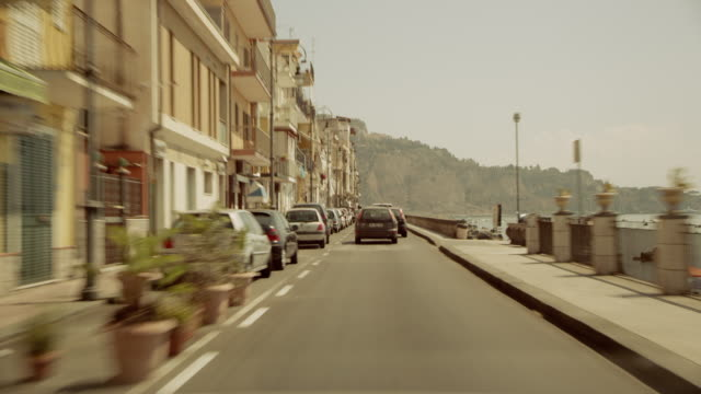 Driving on a street in a city next to the mediterranean sea