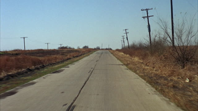 1966 POV Driving on country road near Crandell / Texas, USA.