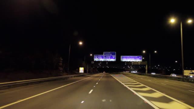 POV Driving on M25 motorway at night / London, United Kingdom