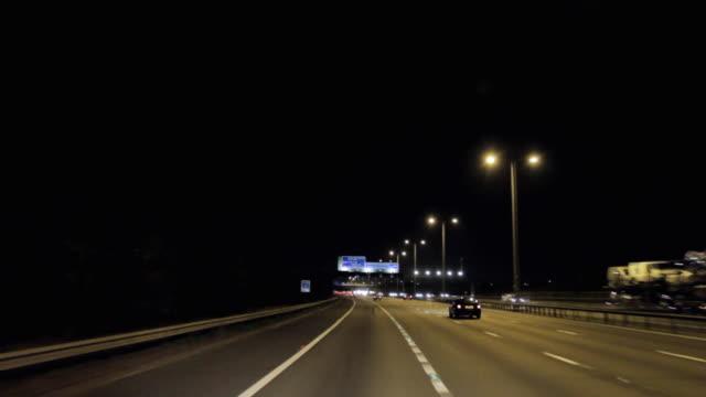 T/L POV Driving on M25 motorway at night / London, United Kingdom