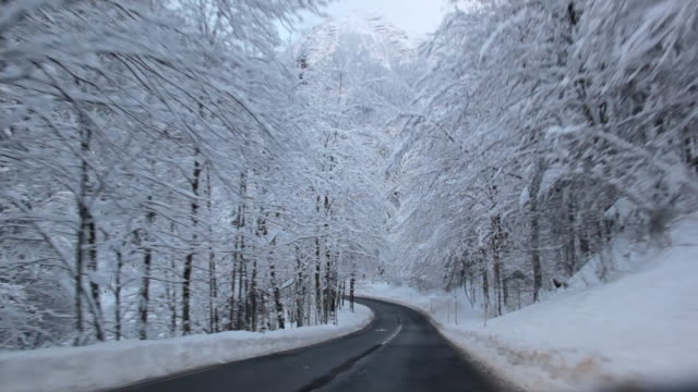 POV Driving on mountain road in snow, Bad Ischl, Austria