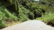 POV Driving on road through mountains near Cima, California, USA