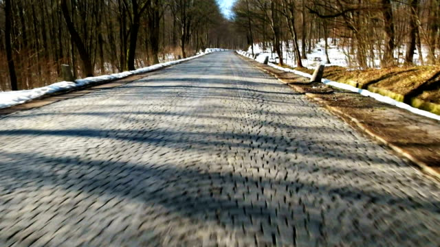 Driving on road with cobblestones