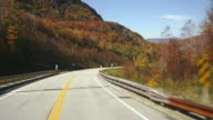 T/L POV Driving on route 112 between Woodstock and Easton, Autumn / New Hampshire, USA