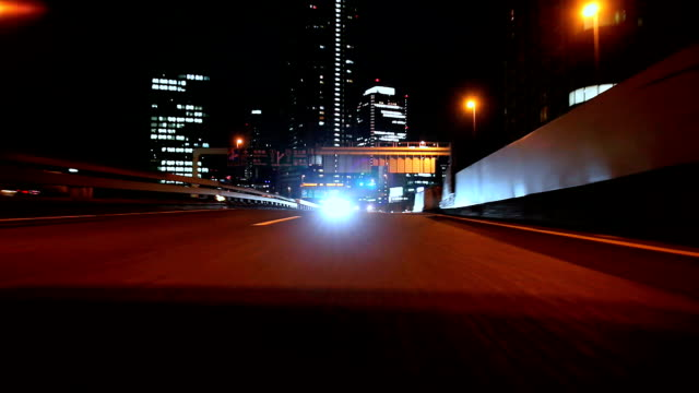Driving on the highway at night -rear view-