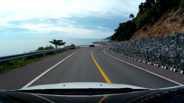 Driving on the Road by the sea