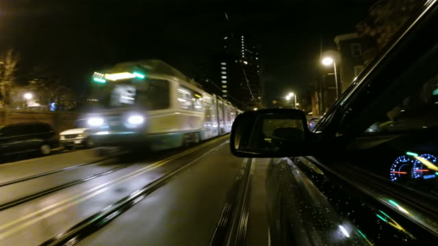 Driving past a Green line streetcar in Boston