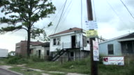 PASSENGER POV driving past abandoned houses in the Ninth Ward/ New Orleans, Louisiana