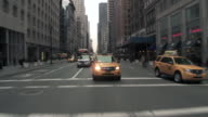 Driving Reverse POV of 5th avenue from 43th to 40th St on a grey day.  Traffic creaps on 5th Ave