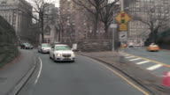 Driving Reverse POV crossing Central Park at 65th street going from the west side to the east on a grey day.