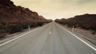 Driving shot through desert mountain pass (fast motion)