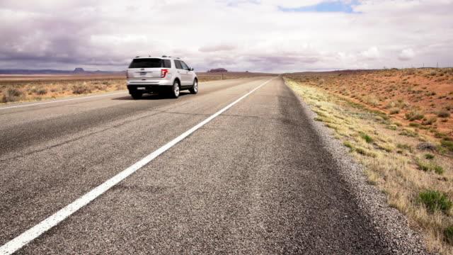 DS SUV driving through a desert
