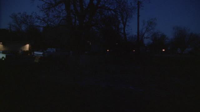 POV Driving through a moon-lit neighborhood at night / Kaufman, Texas, United States