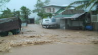 POV driving through extreme flood flowing through village and almost getting swept away, Philippines, Typhoon Parma, 2009