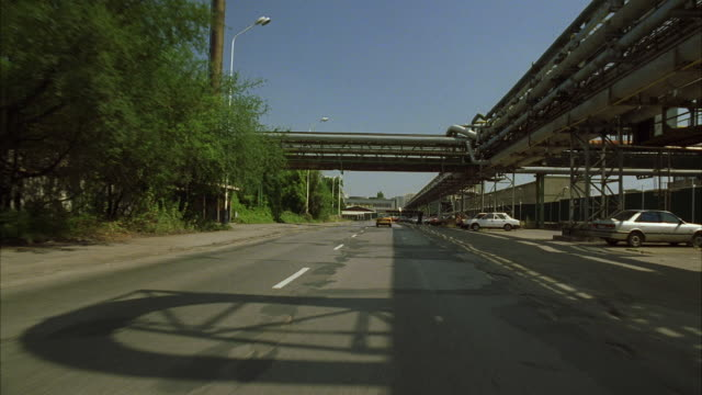 POV Driving through industrial area of Eastern European city