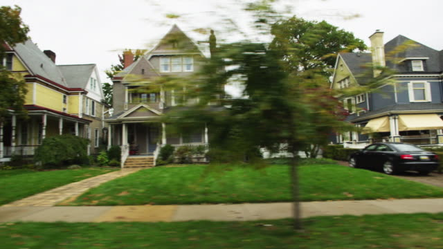SIDE POV Driving through residential district, Sewickley, Pennsylvania, USA