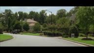 POV Driving through upscale neighborhood