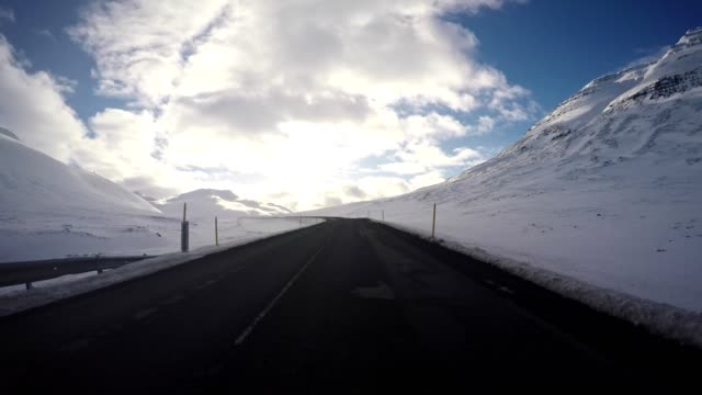 driving under the snowfall in iceland
