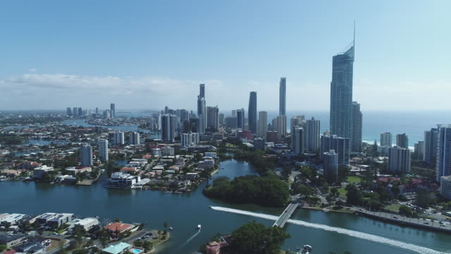 Drone aerial Surfers Paradise Isle of Capri suburban housing looking towards Gold Coast coastal strip skyscraper skyline pan to Capri on Via Roma...