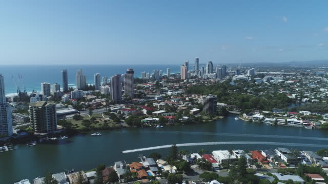 Drone aerial Surfers Paradise looking North towards Southport over Nerang River Girung Island pan east to Gold Coast skyline and further south seeing...
