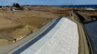 Drone and handheld camera footage taken recently in Kesennuma Miyagi Prefecture shows work progressing on the bed of the Okinotagawa river between...