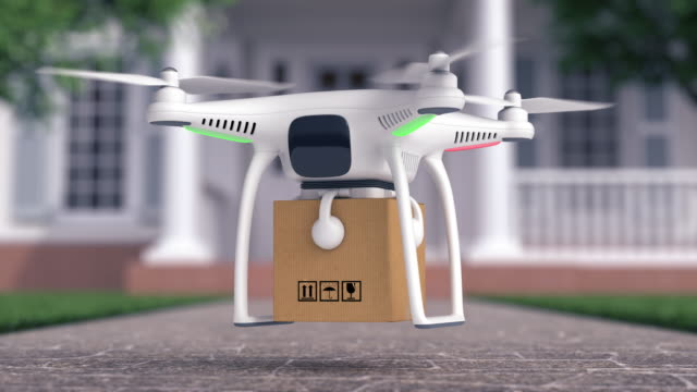 Drone delivers a parcel in fron of the house