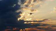 4K Drone flying in sky at sunset